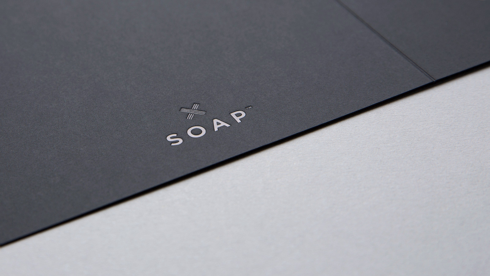 SOAP™ branding – logo featuring deep embossing with black on black foil