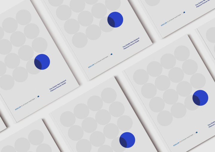 Essilor NZ Platinum Partners brochure – multiple front covers featuring series of circles and cobalt blue overlap