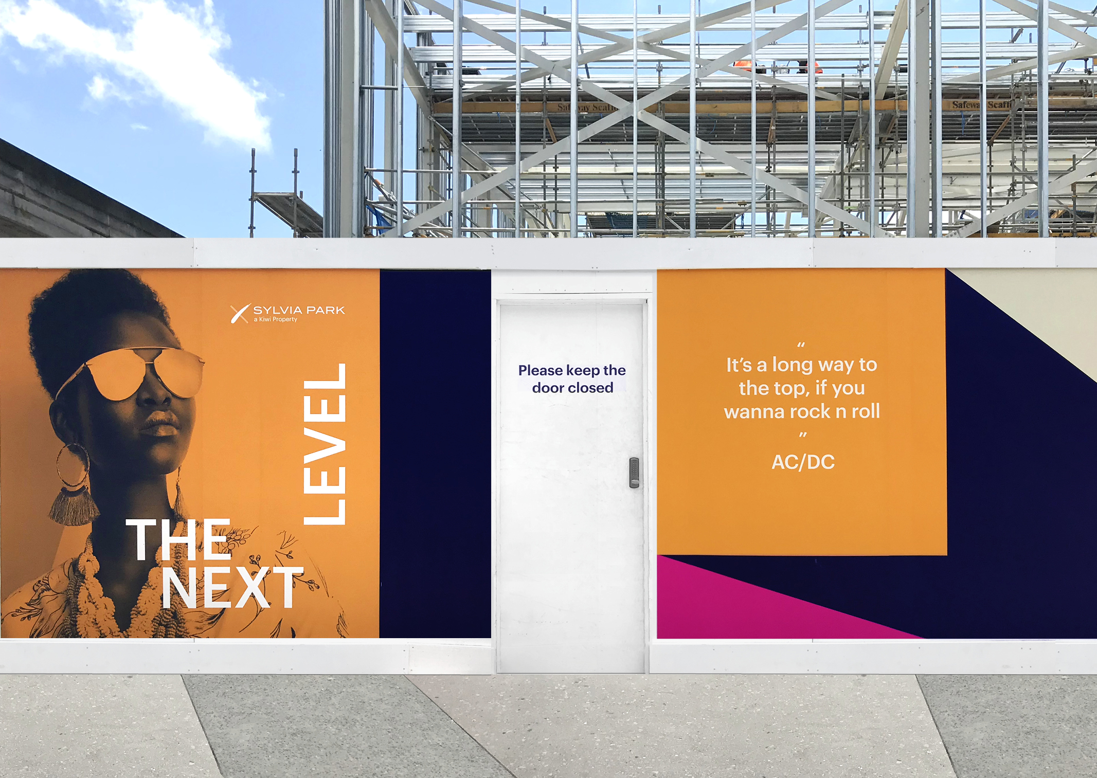 Close up of eye catching and sophisticated hoarding series for Sylvia Park Mall featuring Next Level Identifier brand in bright orange