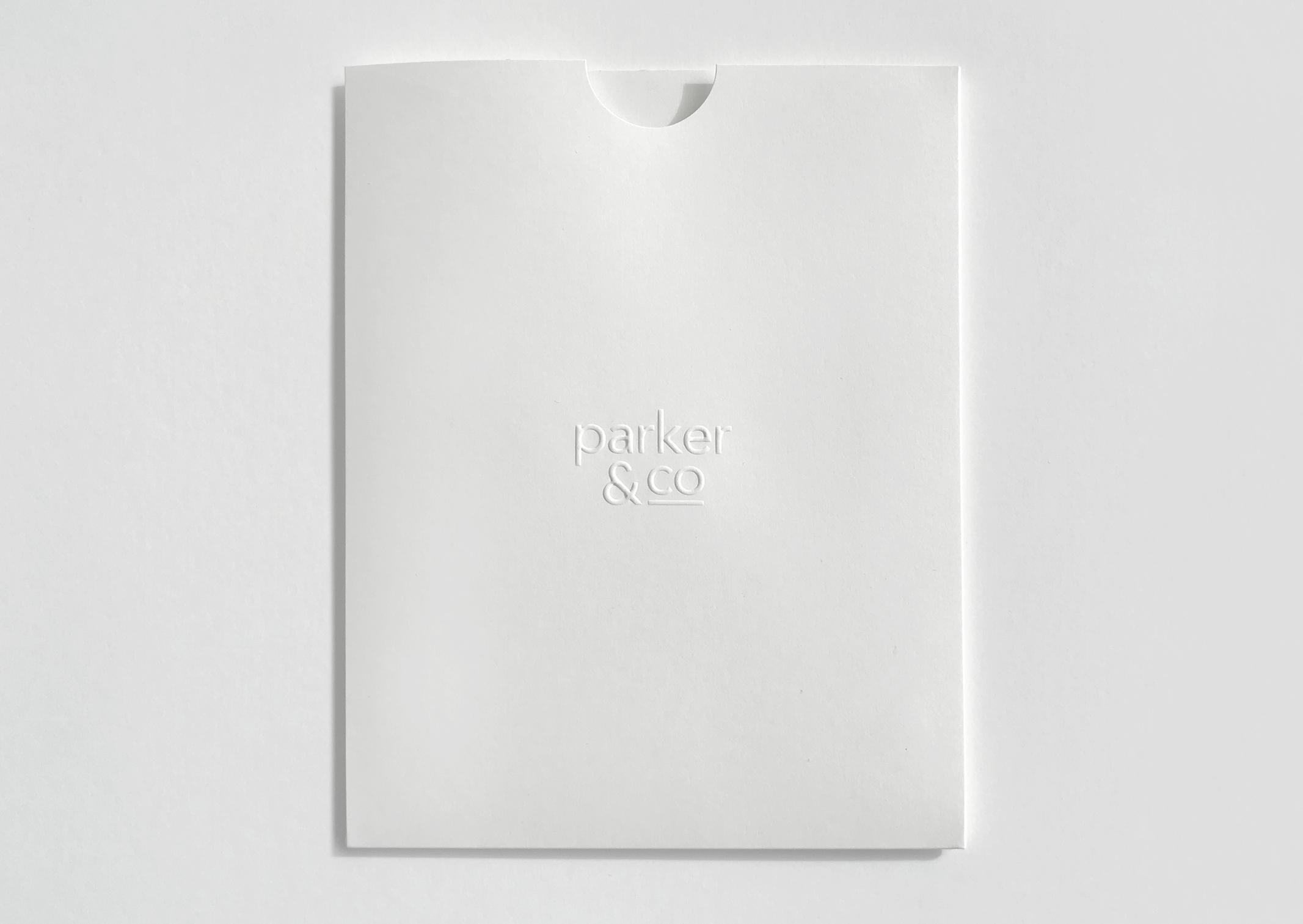 Parker and Co Branded Pocket – blind embossed – white on white