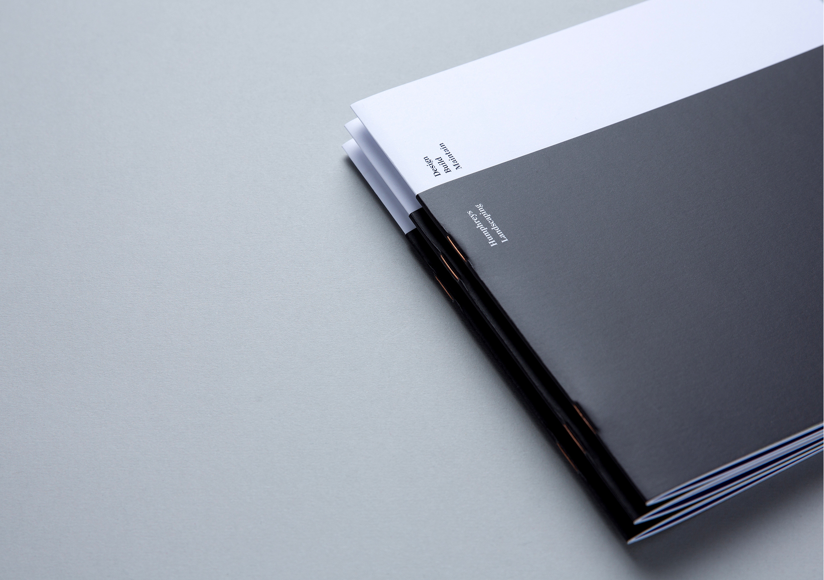 Humphreys Landscaping Brochure – stack of black and white covers