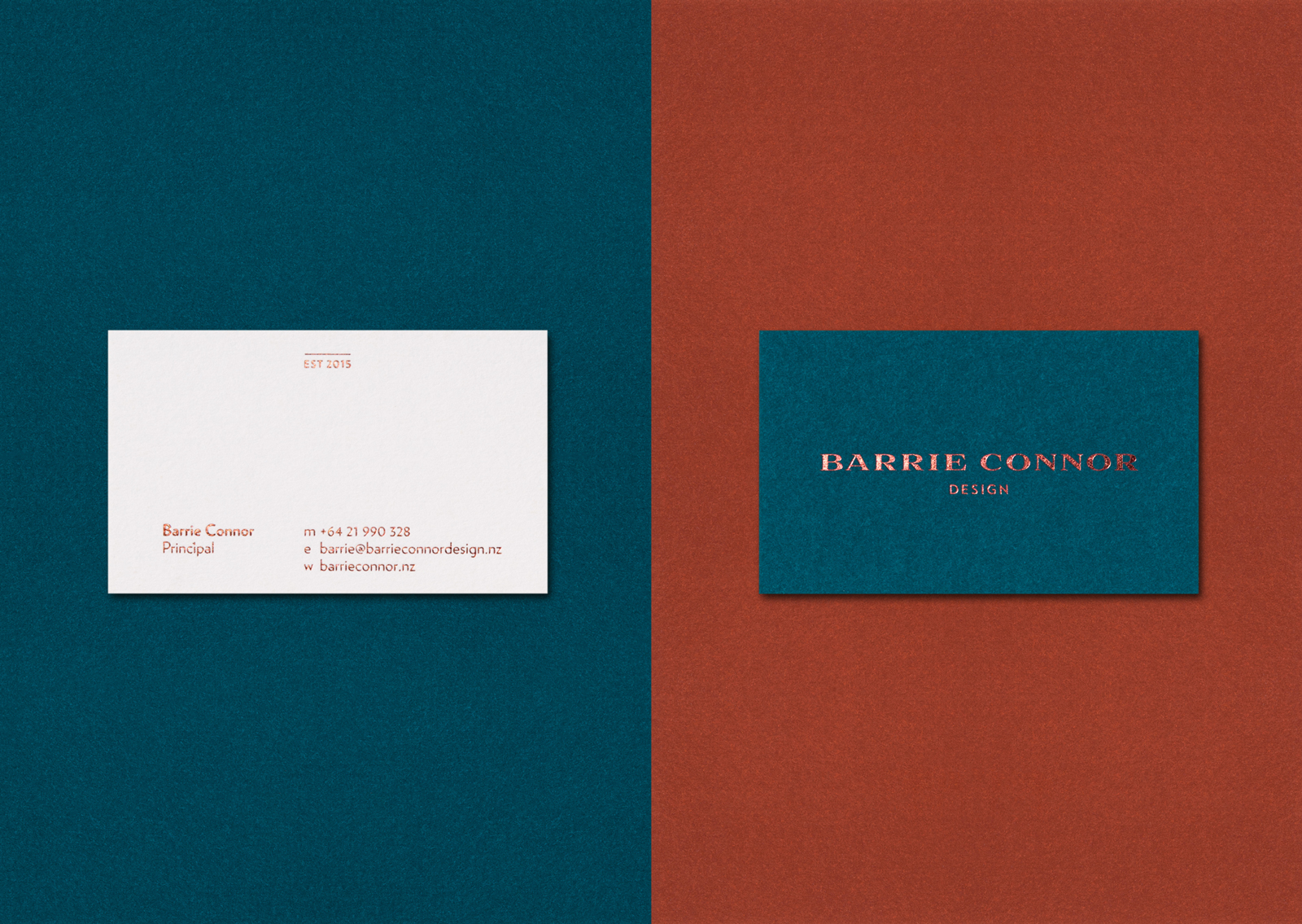 Minimal copper foil typography and Rich tan and delft blue contrast on the trio of Barrie Connor business cards