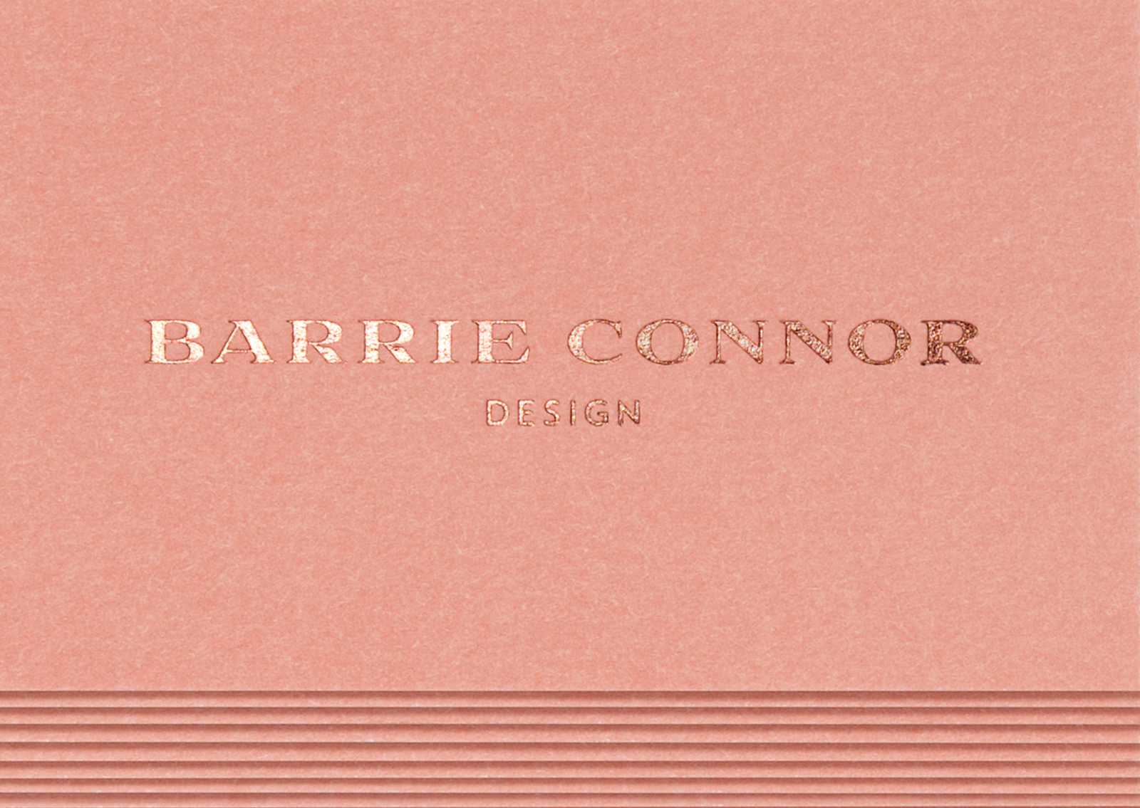 Blush pink with copper foil typography is one of 3 bespoke colours of Barrie Connor business cards