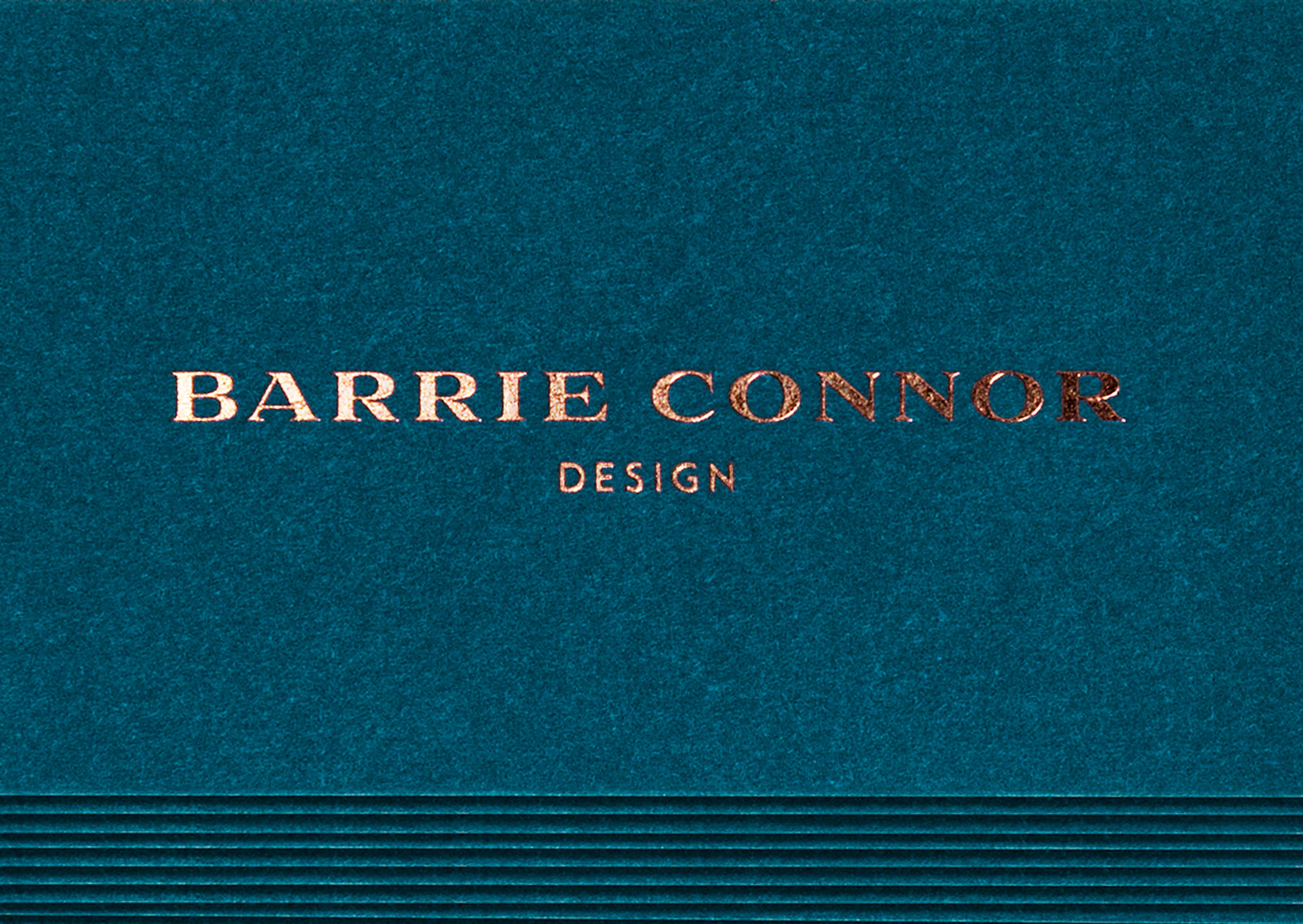 A rich delft blue with copper foil typography is one of 3 bespoke colours of Barrie Connor business cards