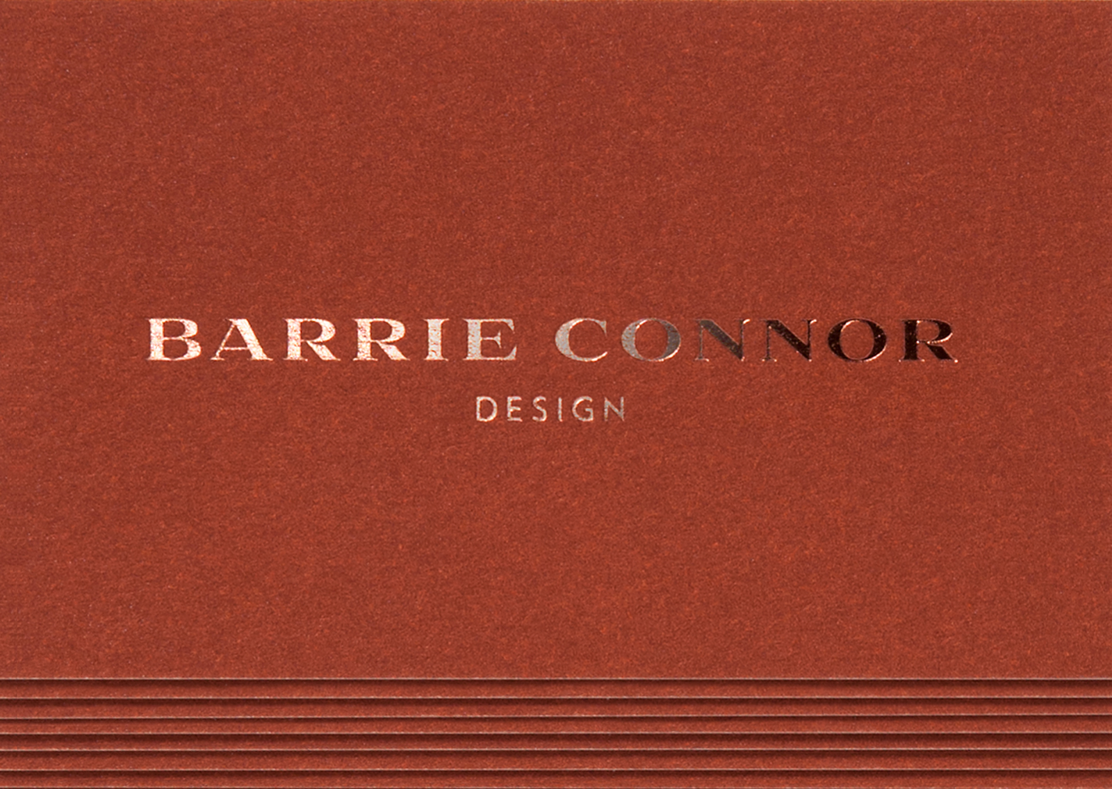 A rich tan with copper foil typography is one of 3 bespoke colours of Barrie Connor business cards