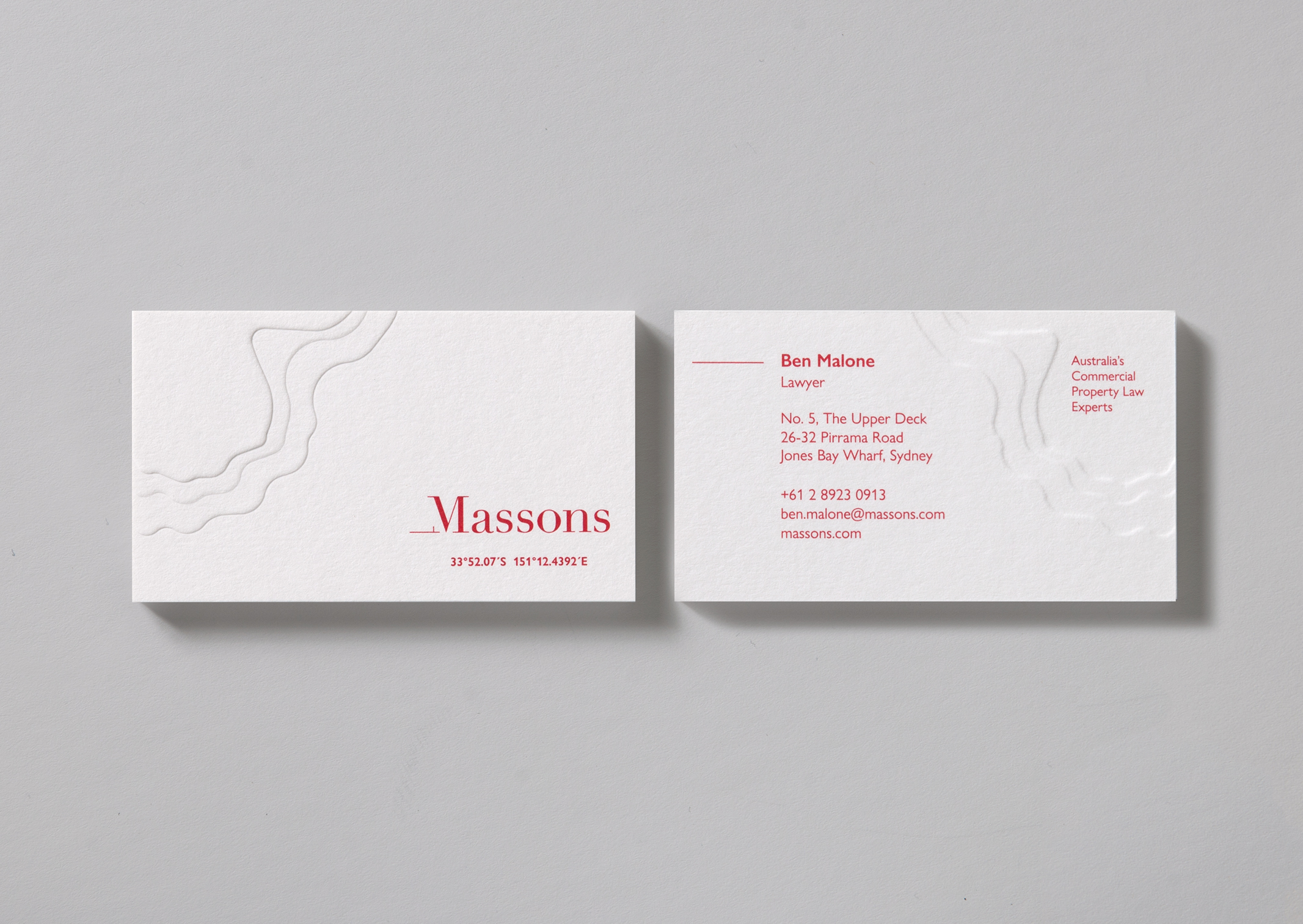 Massons Law business cards feature a deep topographic map emboss and location coordinates