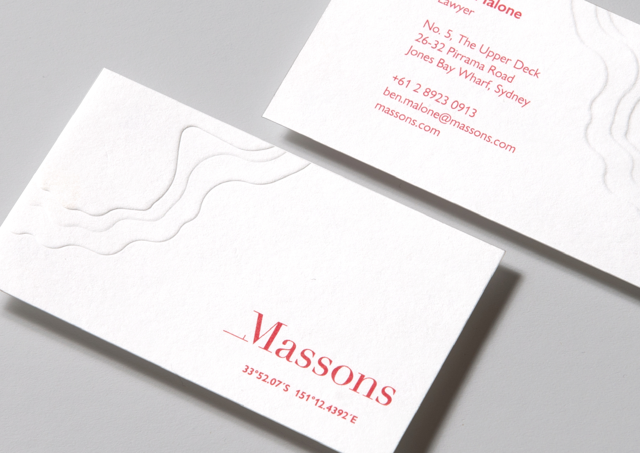 Massons business cards feature a deep topographic map emboss and location coordinates