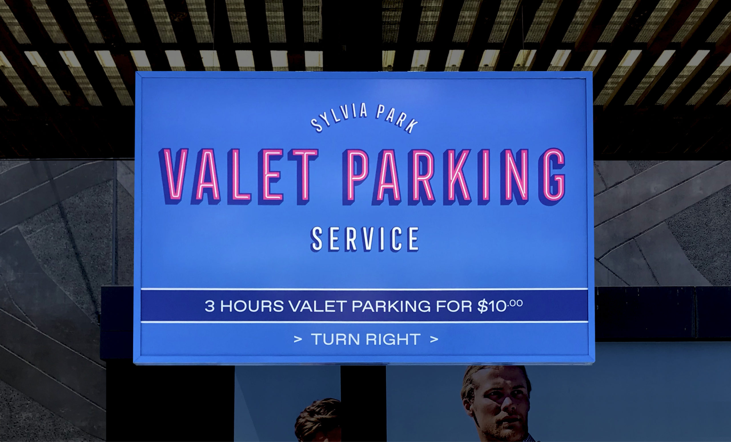 Sign featuring retro themed identity for Sylvia Park Valet Parking Experience featuring neon style lettering