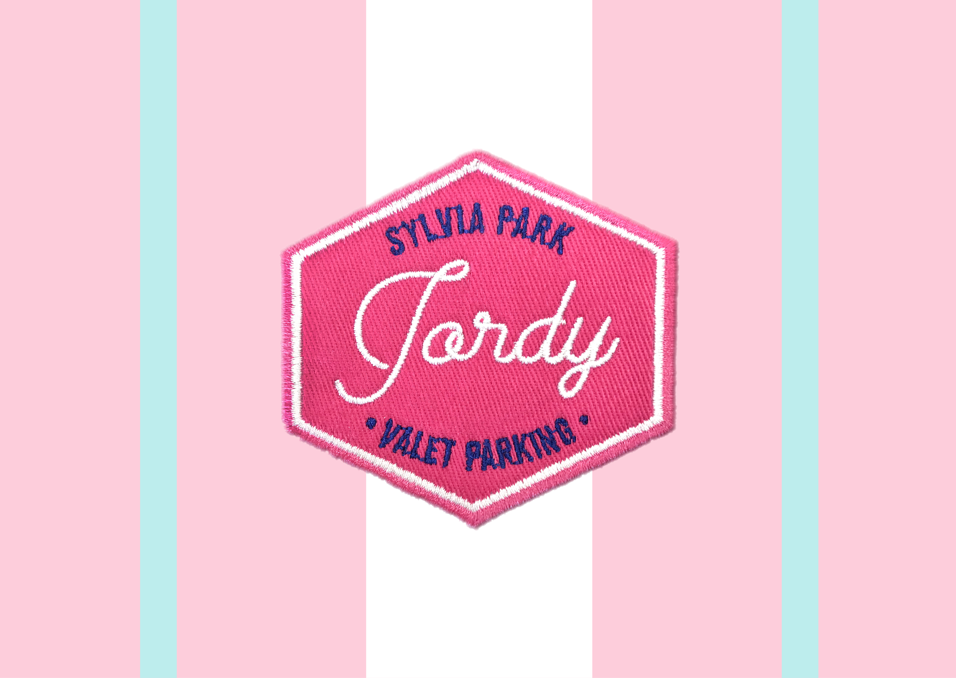 Close up of retro embroidered Sylvia Park Valet Parking Experience attendant name badge
