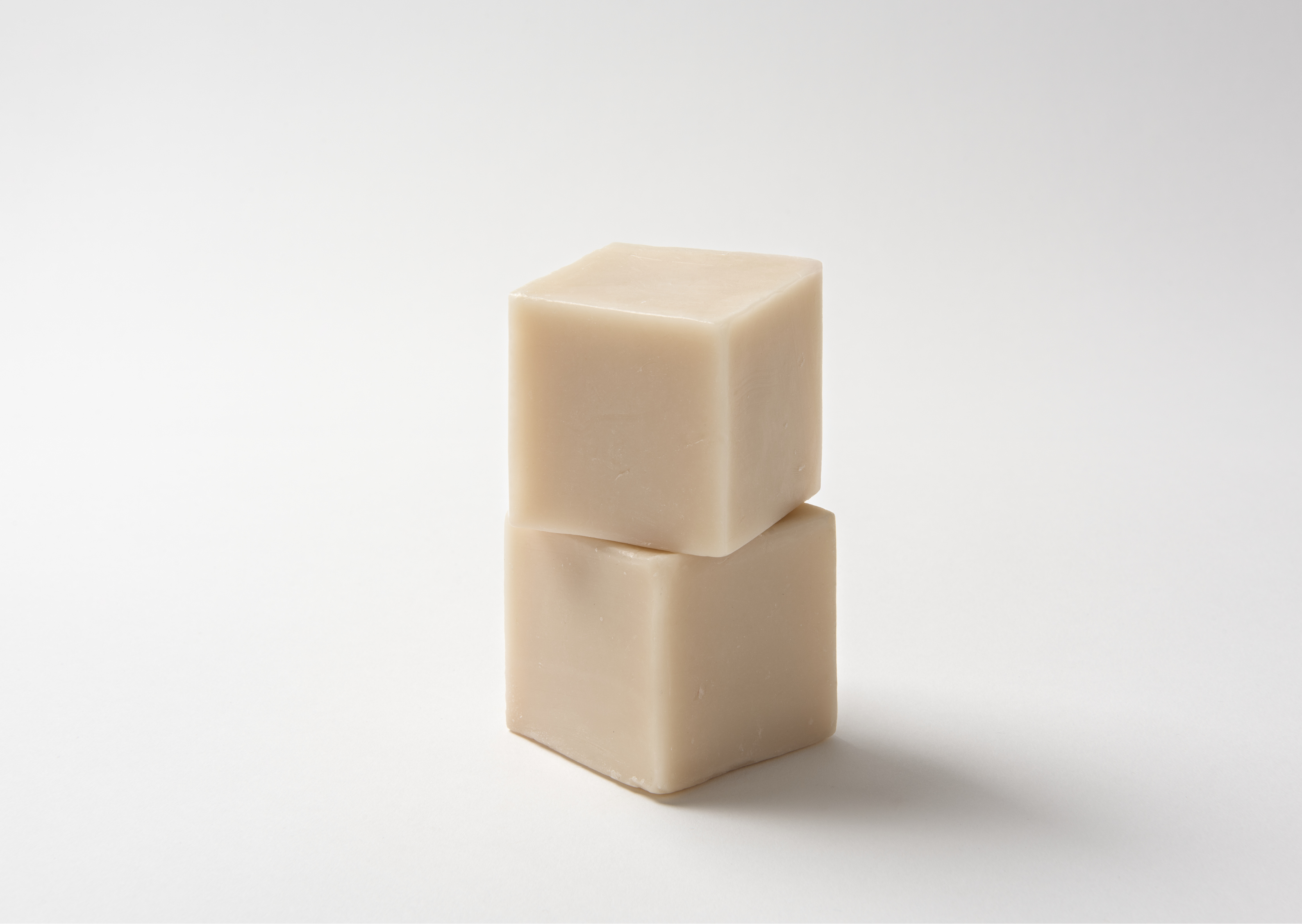 Two stacked cubes of handmade soap