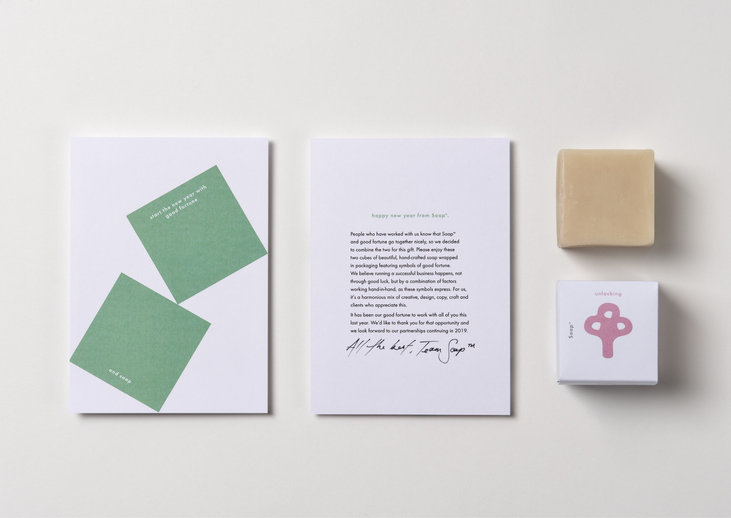 Client gift card featuring two teal cubes and soap in illustrated packaging