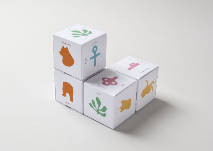 Multiple stacking cubes of soap packaging with fortune themed illustrations