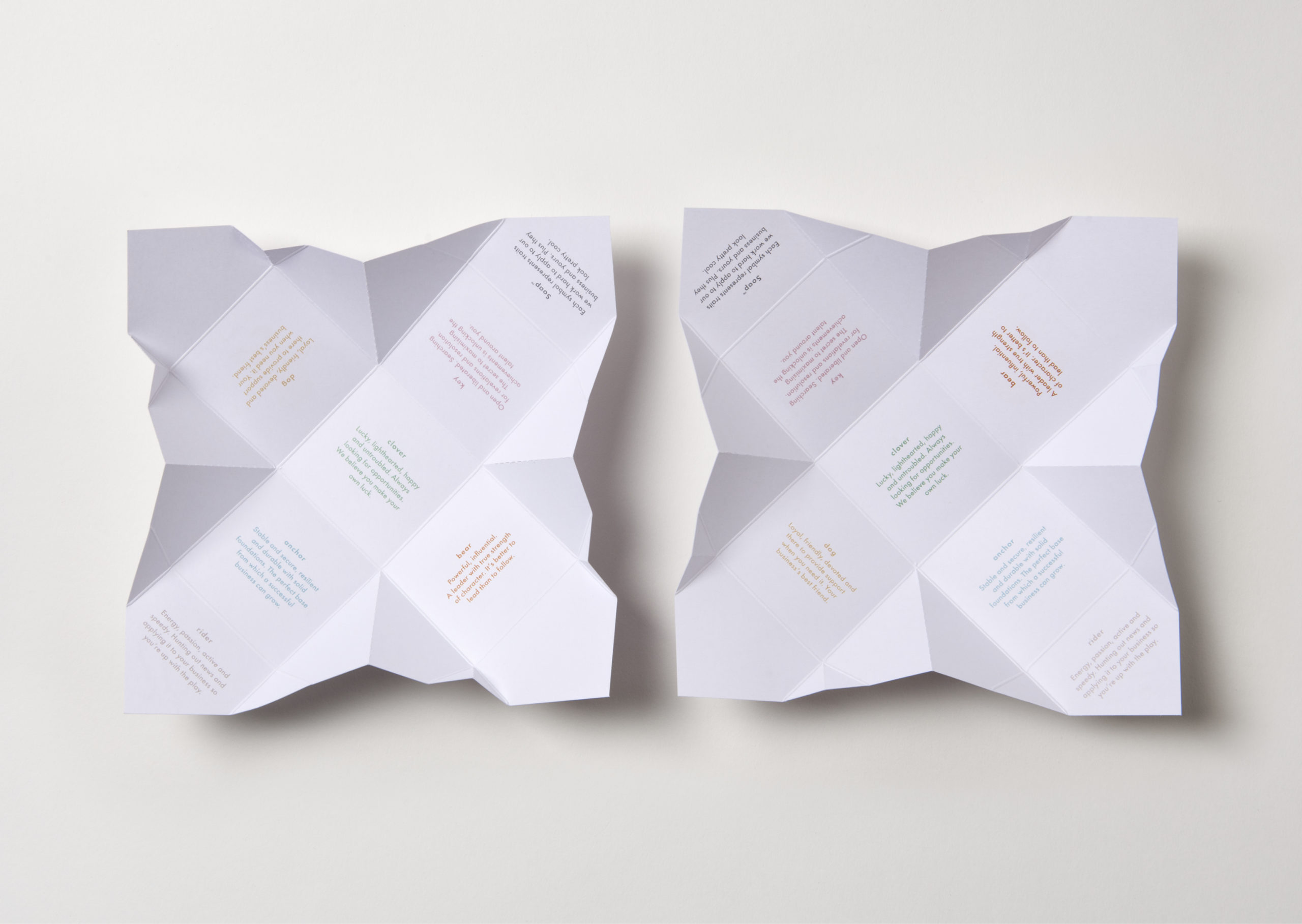 Two open origami folded Soap packaging designs showing fortune messages