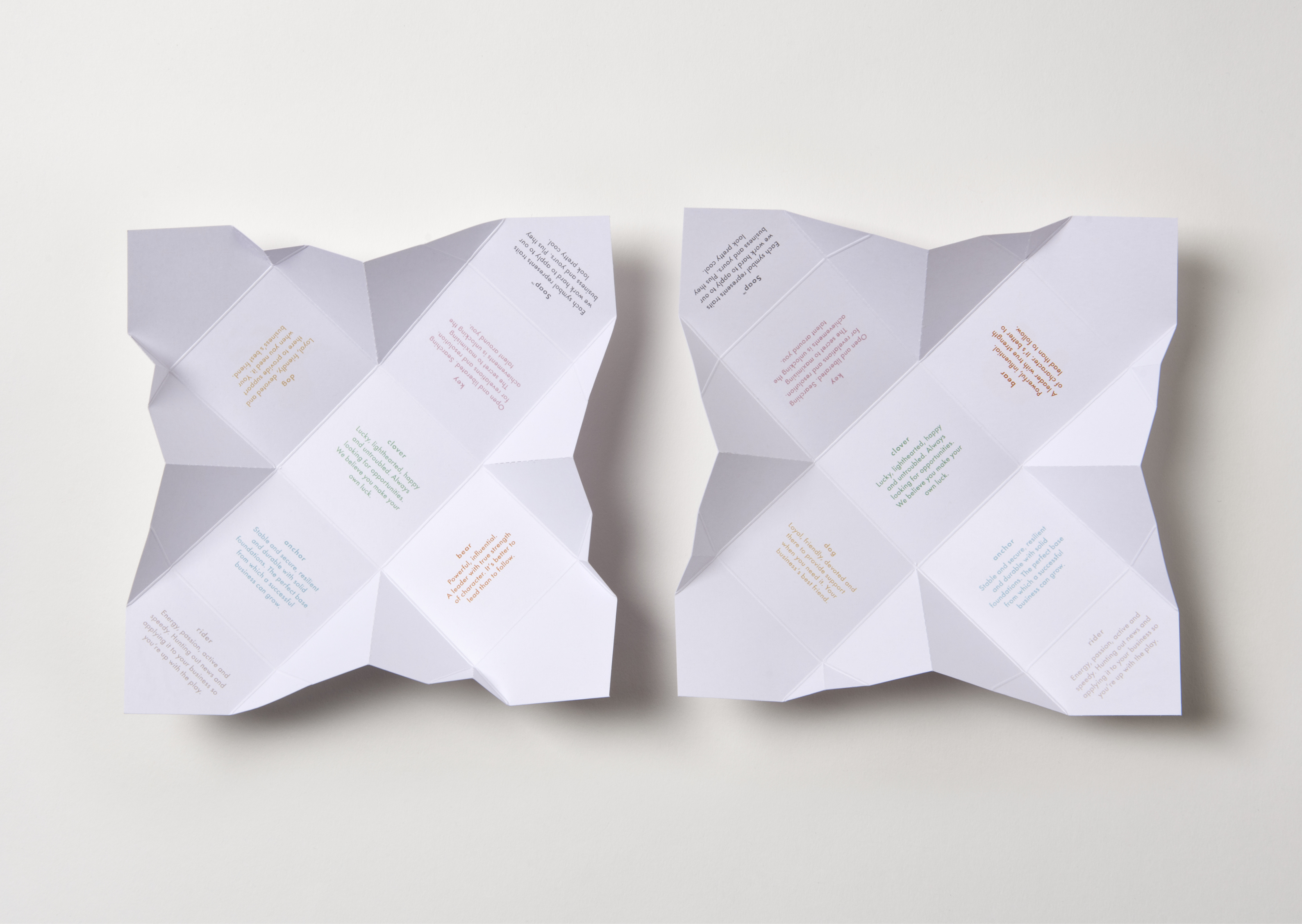 Two open origami folded Soap packaging showing fortune messages