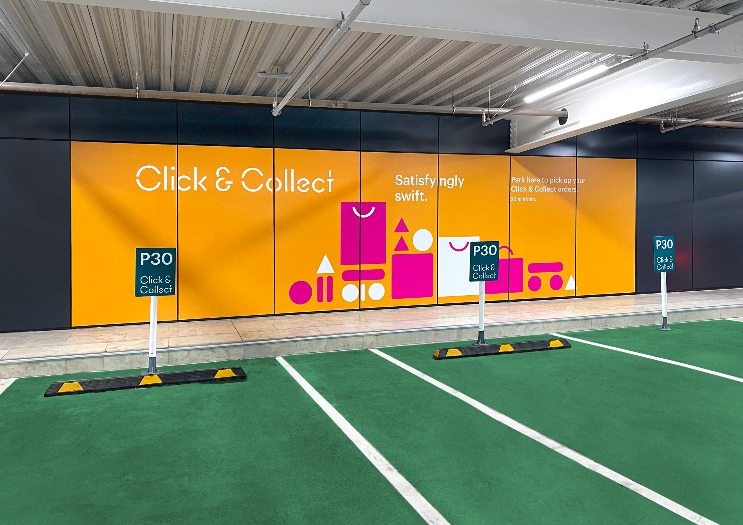 Click & Collect hoarding showing logo and illustration Interior Signage at Sylvia Park