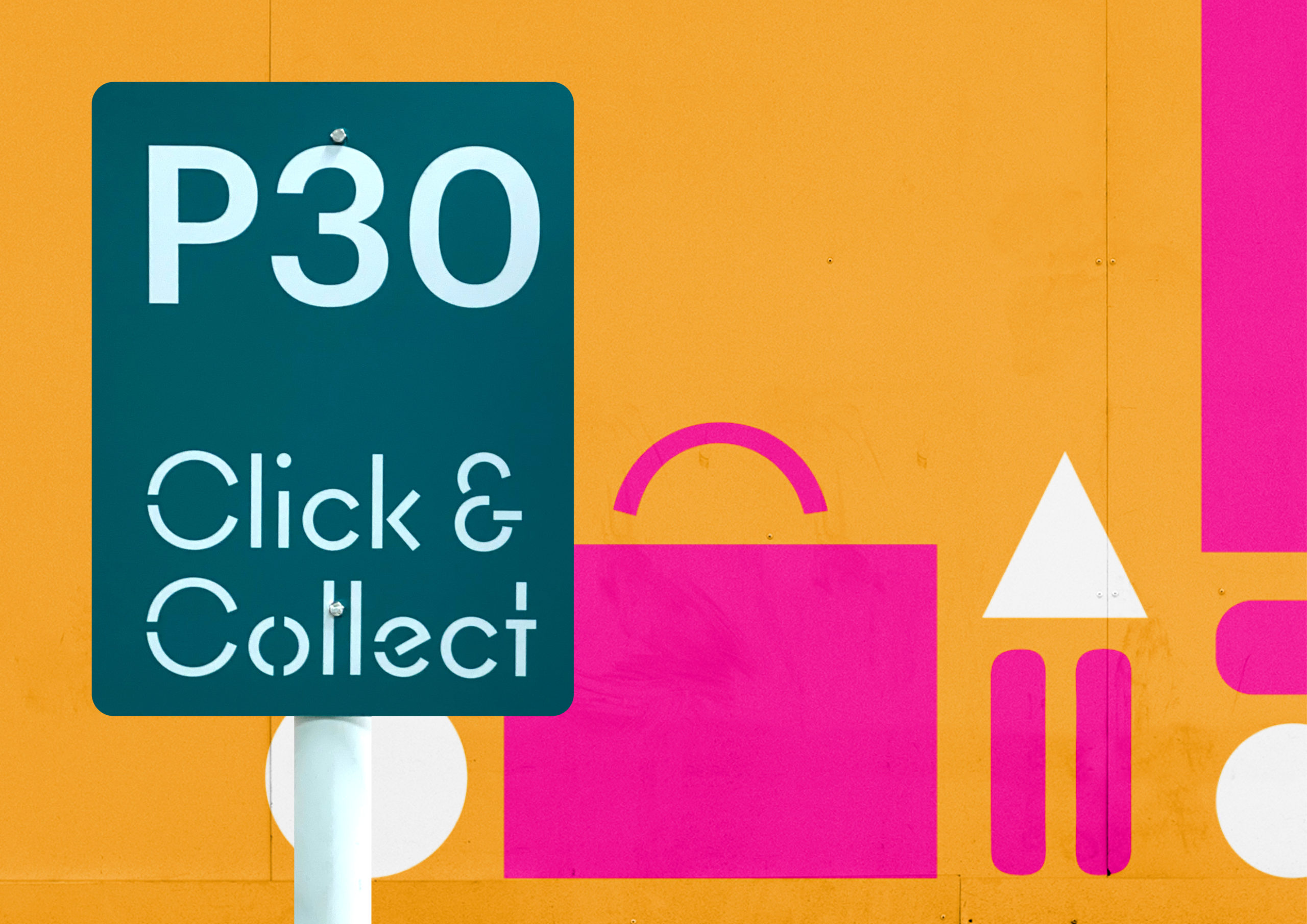 Close up of Click & Collect parking sign in front of hoarding at Sylvia Park
