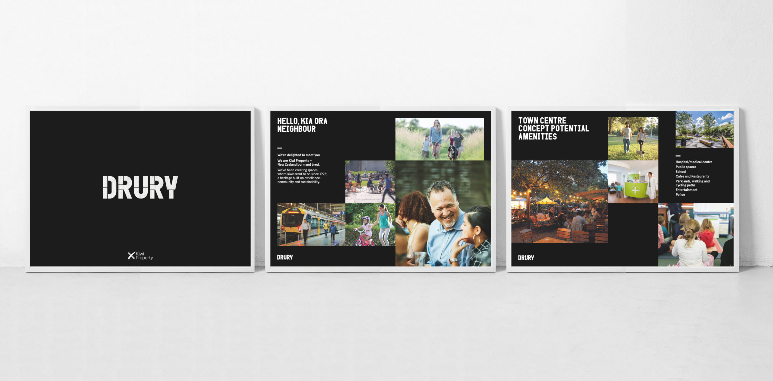 series of large scale presentation boards black backgrounds and imagery depicting future development Drury community development communications
