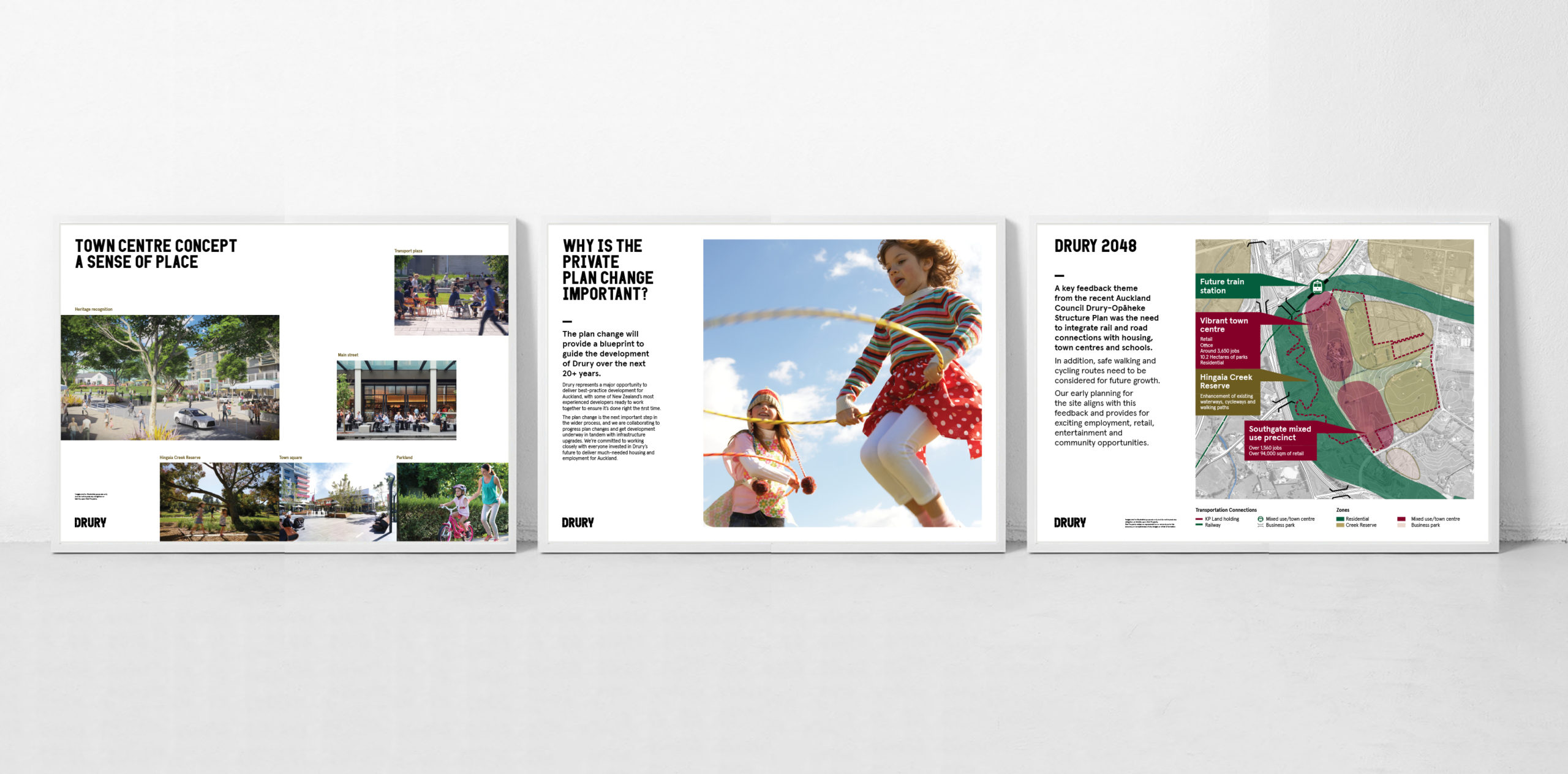 series of large scale presentation boards with white backgrounds and imagery depicting future development Drury community development communications