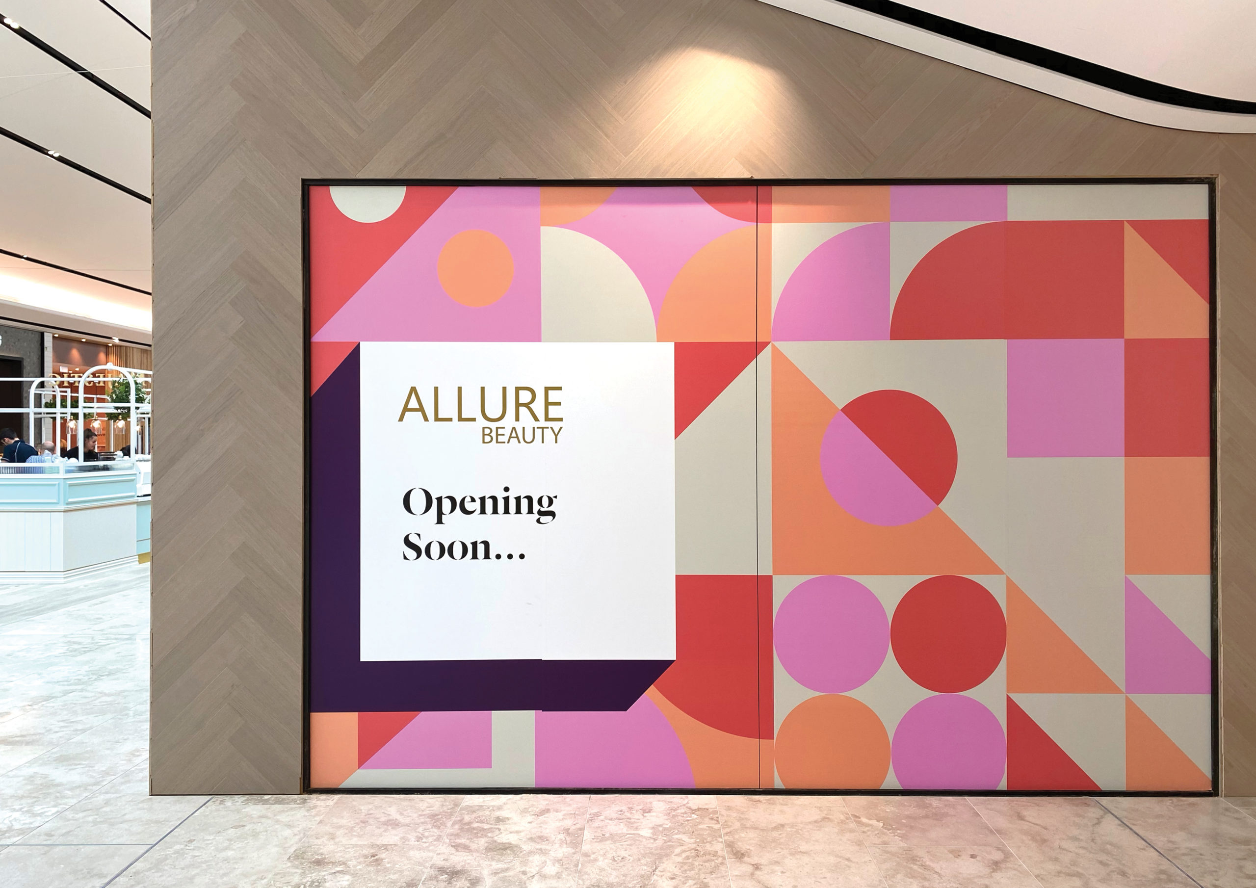 Large scale retail graphics at Sylvia Park Level 1 Launch featuring an eye-catching pink and peach geometric pattern