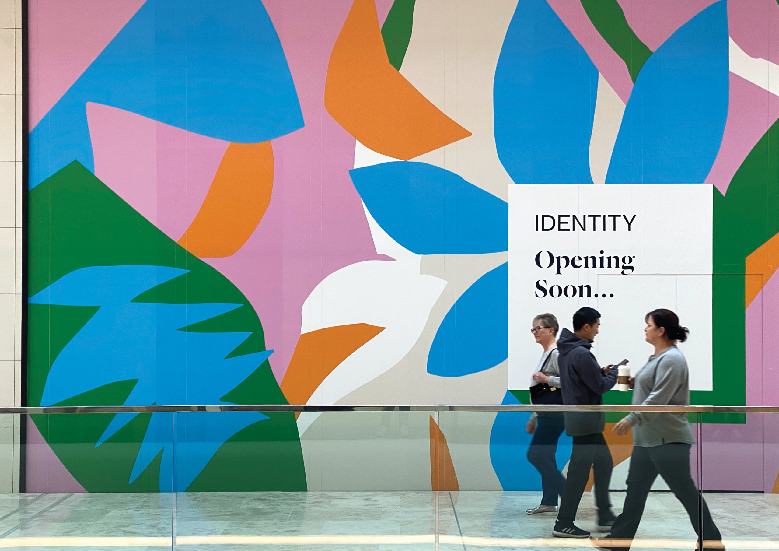 Large scale retail graphics at Sylvia Park Level 1 Launch featuring brightly coloured oversized leaf and flower illustrations