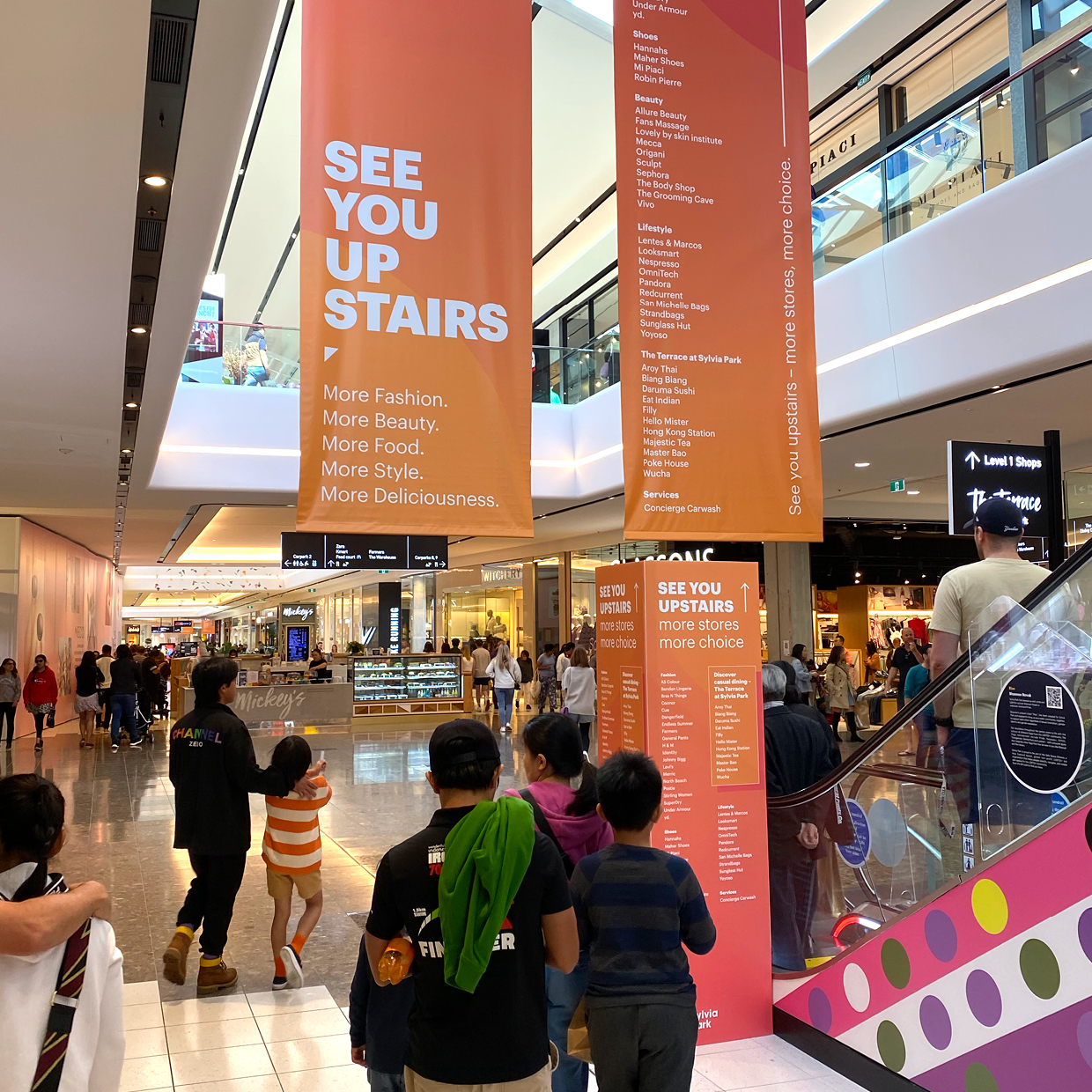 dramatic hanging banners help drive foot traffic to new Level 1 retailers at Sylvia Park