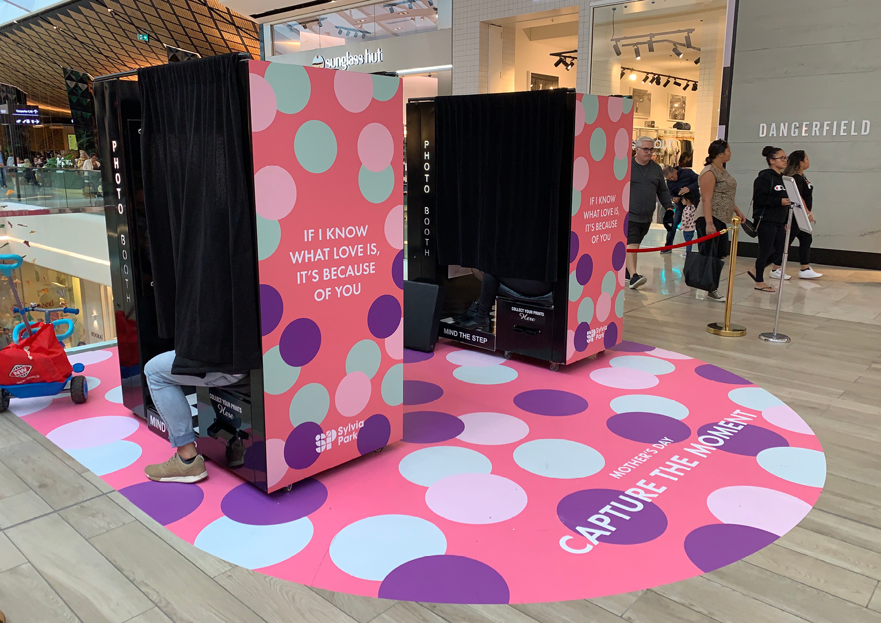 Two playfully coloured photo booths on the floor at Sylvia Park Shopping Centre as part of retail activation