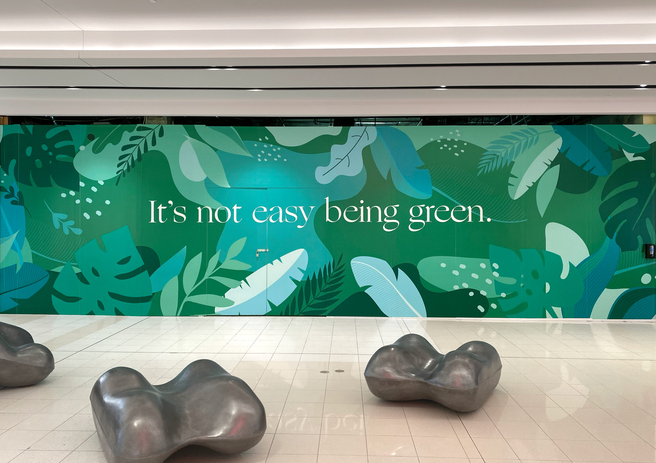 It's not easy being green message atop lush, green leafy background